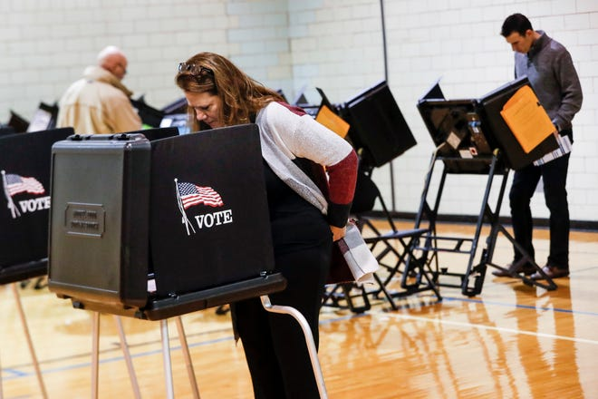 Voters fill out their ballots at the Whetstone Community Center polling location Tuesday in Columbus, Ohio. Polling closes at 7:30 p.m. EST in the state.
