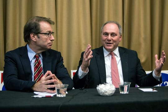 House Majority Whip Steve Scalise, R-La., right, and Republican Rep. Peter Roskam, R-Ill., speak to reporters before a reception for Roskam at the Chicago Marriot Hotel-Naperville, Oct. 17, 2018, in Naperville, Ill.