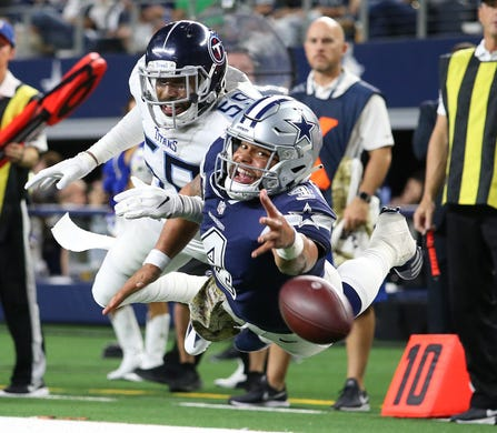 Cowboys quarterback Dak Prescott dives for a pass in the fourth quarter  against Tennessee Titans linebacker 8379ce182
