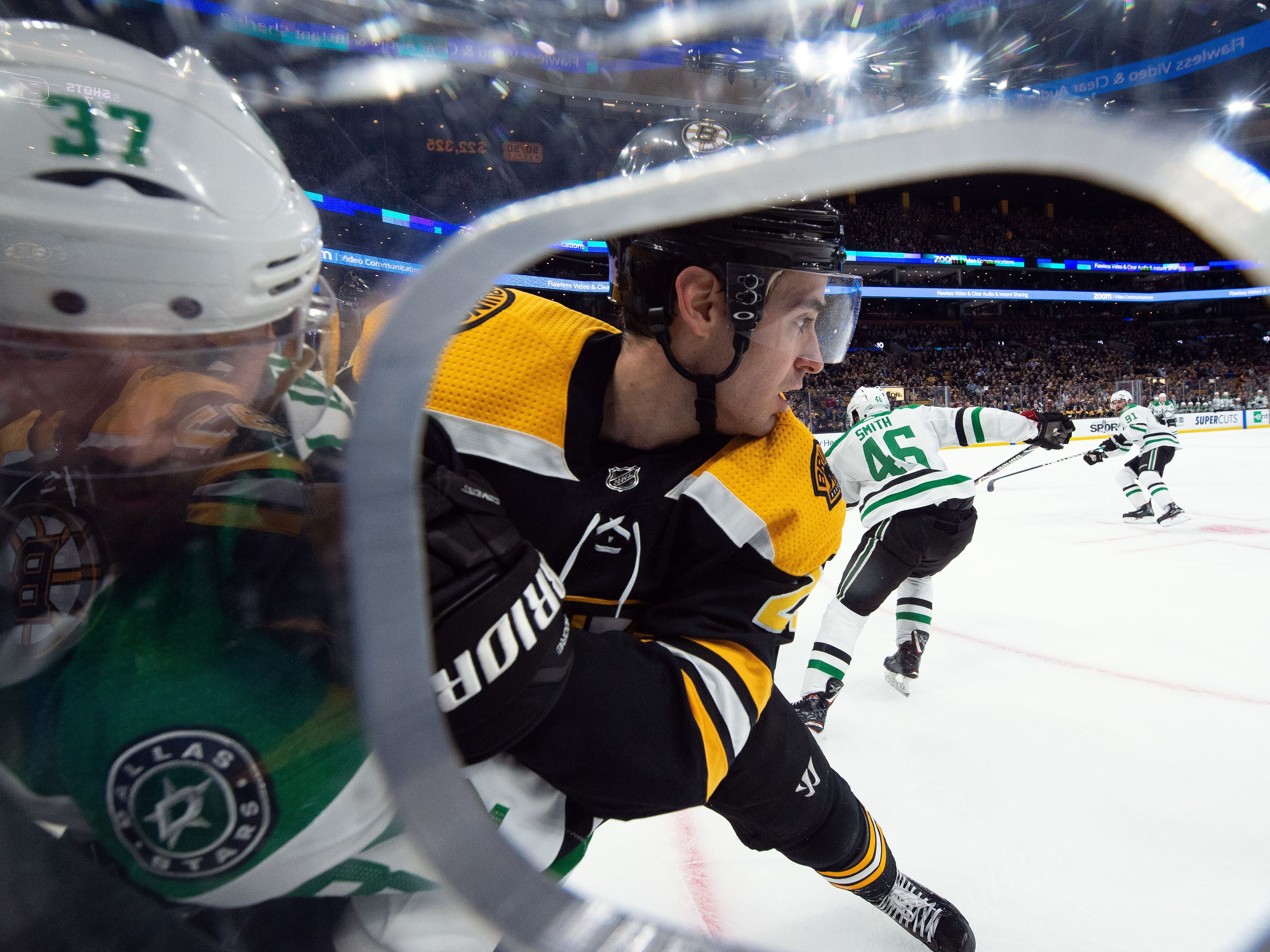 Nov. 5: Boston Bruins defenseman John Moore (27) holds Dallas Stars center Justin Dowling (37) against the boards during the first period at TD Garden.