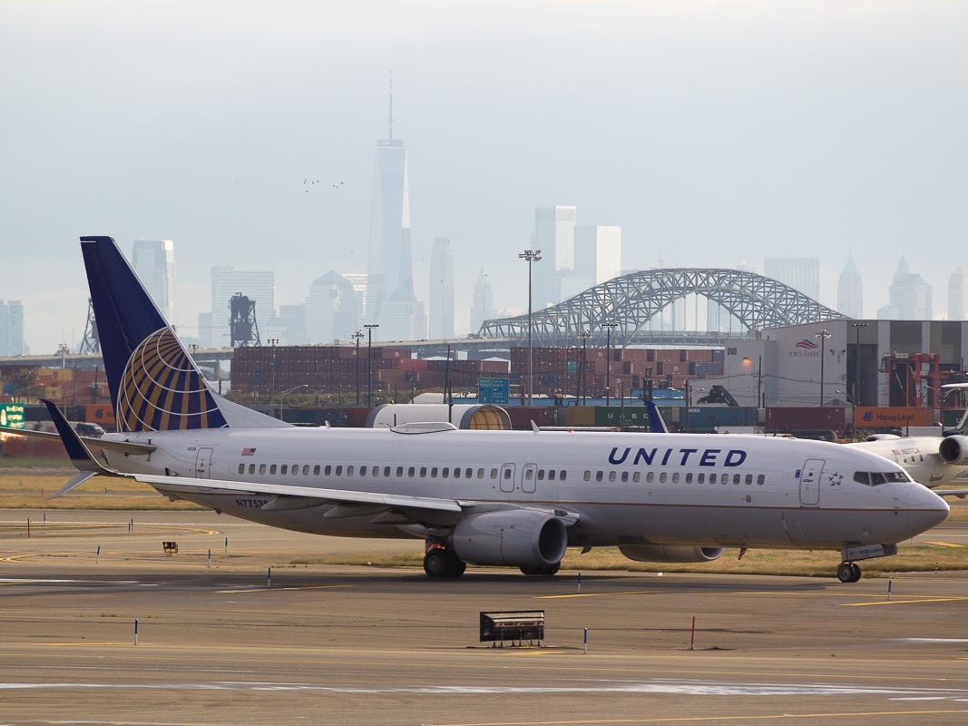 The New York City skyline provides a dramatic backdrop as a United Airlines Boeing 737-800 taxies to the gate after landing at Newark Liberty International Airport in October 2018.