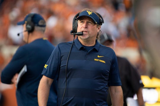 West Virginia coach Dana Holgorsen looks at the scoreboard during the third quarter against Texas.