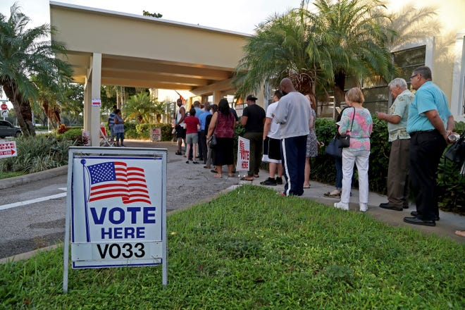 Voters line up as the polls open at David Park Community Center Tuesday, Nov.  6, 2018 in Hollywood, Fla.