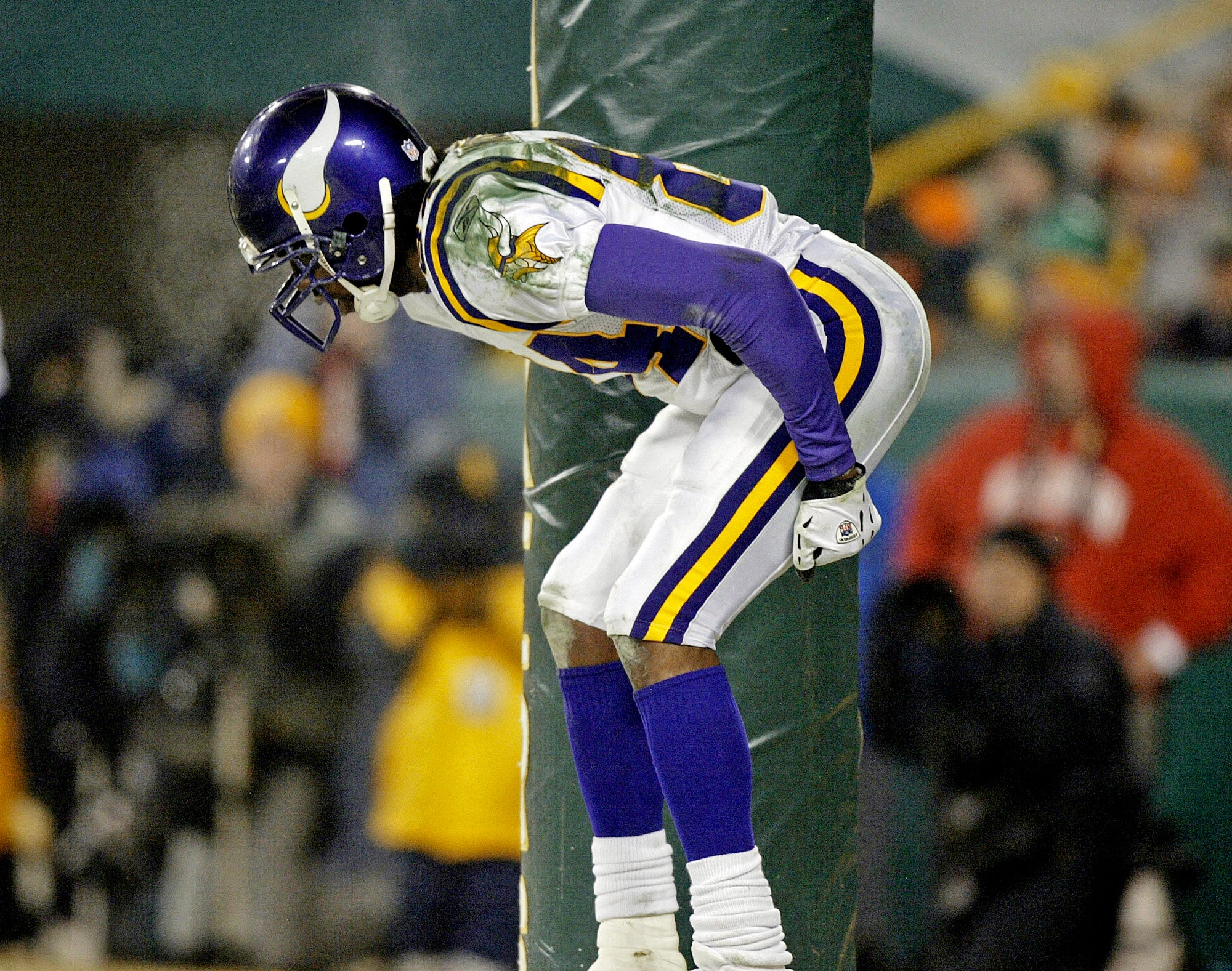 Randy Moss bends over to the crowd after scoring a touchdown in an NFC wild-card playoff game against the Packers on Jan. 9, 2005.