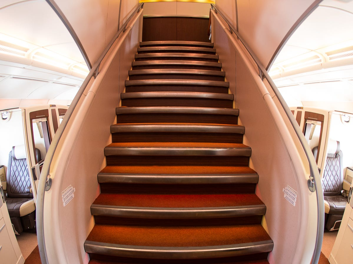The grand staircase of the Airbus A380 is seen aboard a Singapore Airlines' version of the jumbo jet at New York's JFK International Airport in October 2018.