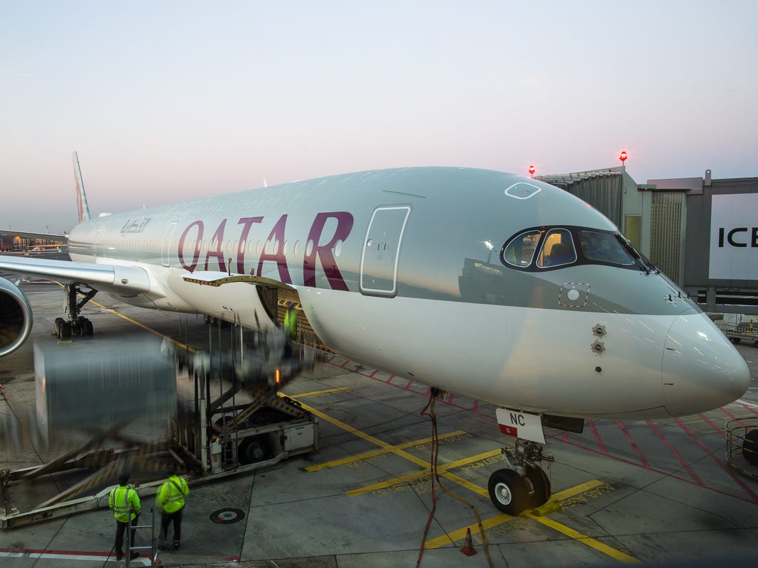 Workers unload cargo from an arriving Qatar Airways Airbus A350-1000 jet at Frankfurt Airport in October 2018.