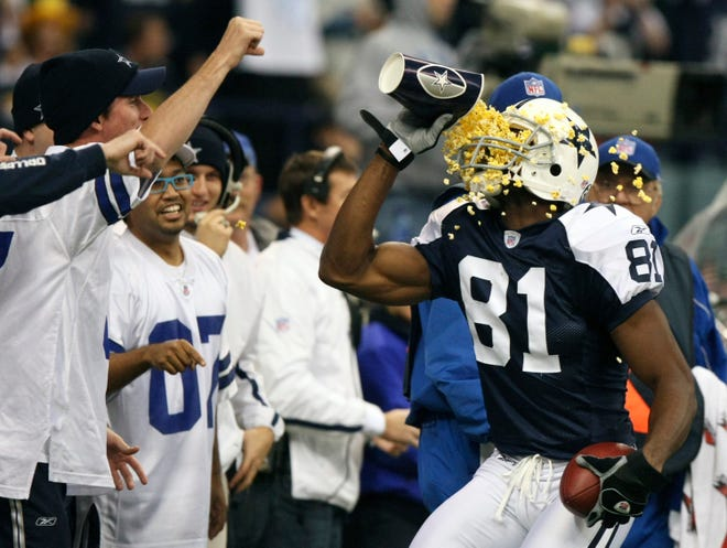 Terrell Owens throws popcorn in his face after scoring a touchdown against the Packers.