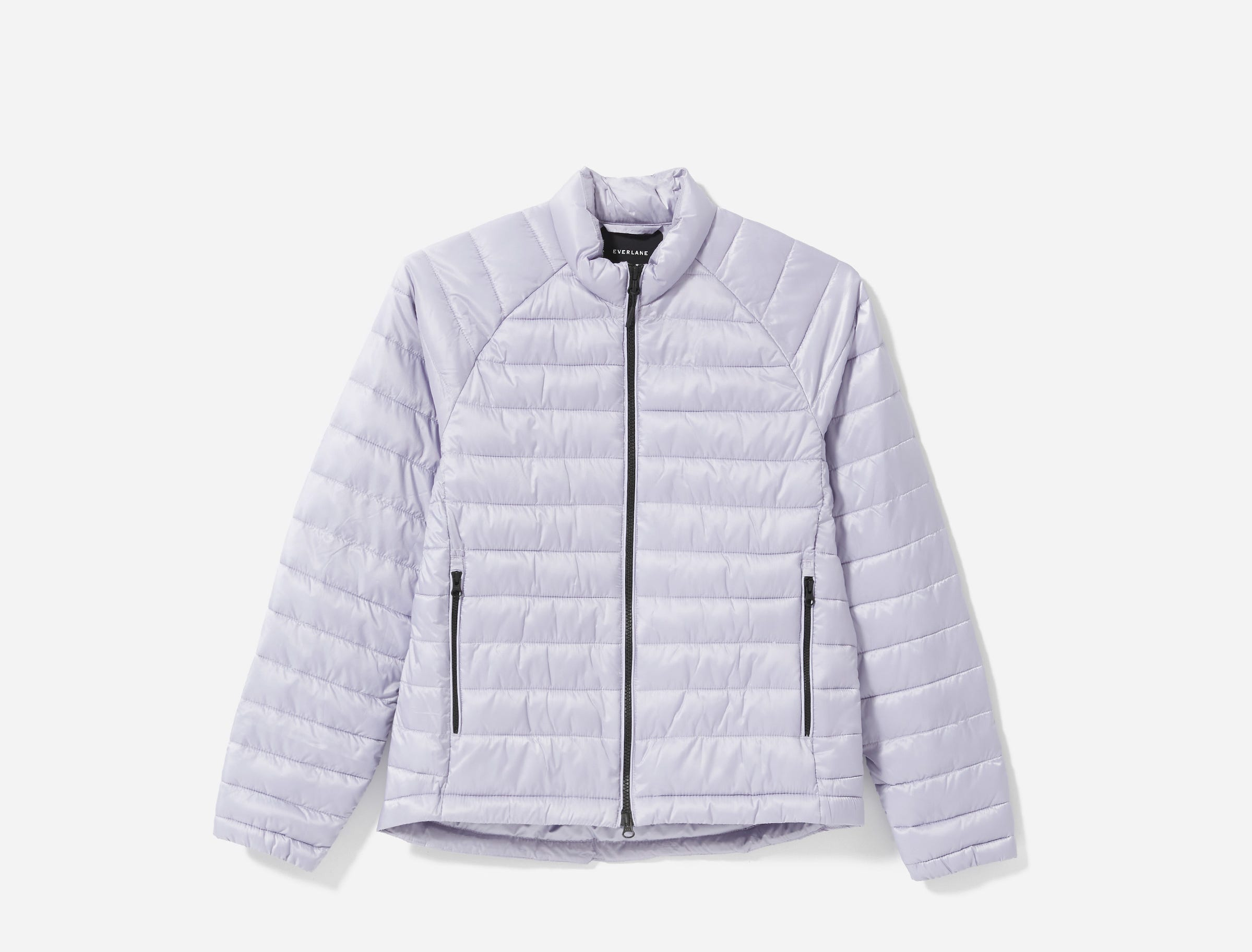 Everlane says 99% of every ReNew product is made from recycled plastic. Only the zippers and trim are not. Here, the line's Light Weight Puffer in lavender, which Everlane says is made with 15 recycled plastic bottles.