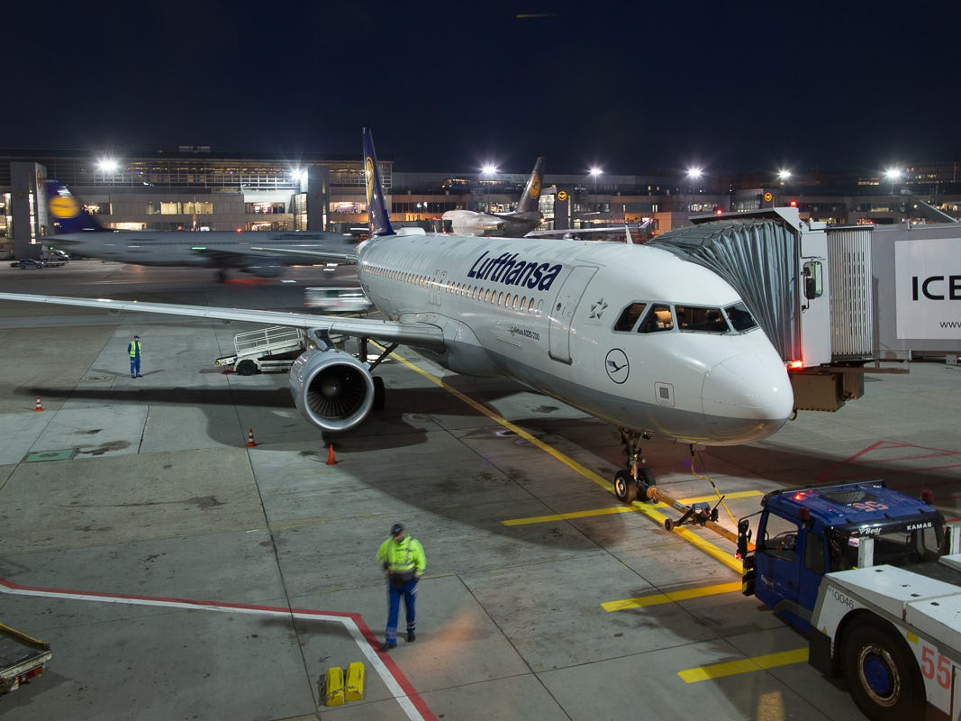 A Lufthansa Airbus A320 is prepped for its next flight in the early morning hours at the Frankfurt Airport in October 2018.