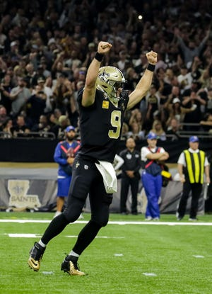 New Orleans Saints quarterback Drew Brees (9) celebrates after a touchdown against the Los Angeles Rams during the second quarter at the Mercedes-Benz Superdome.