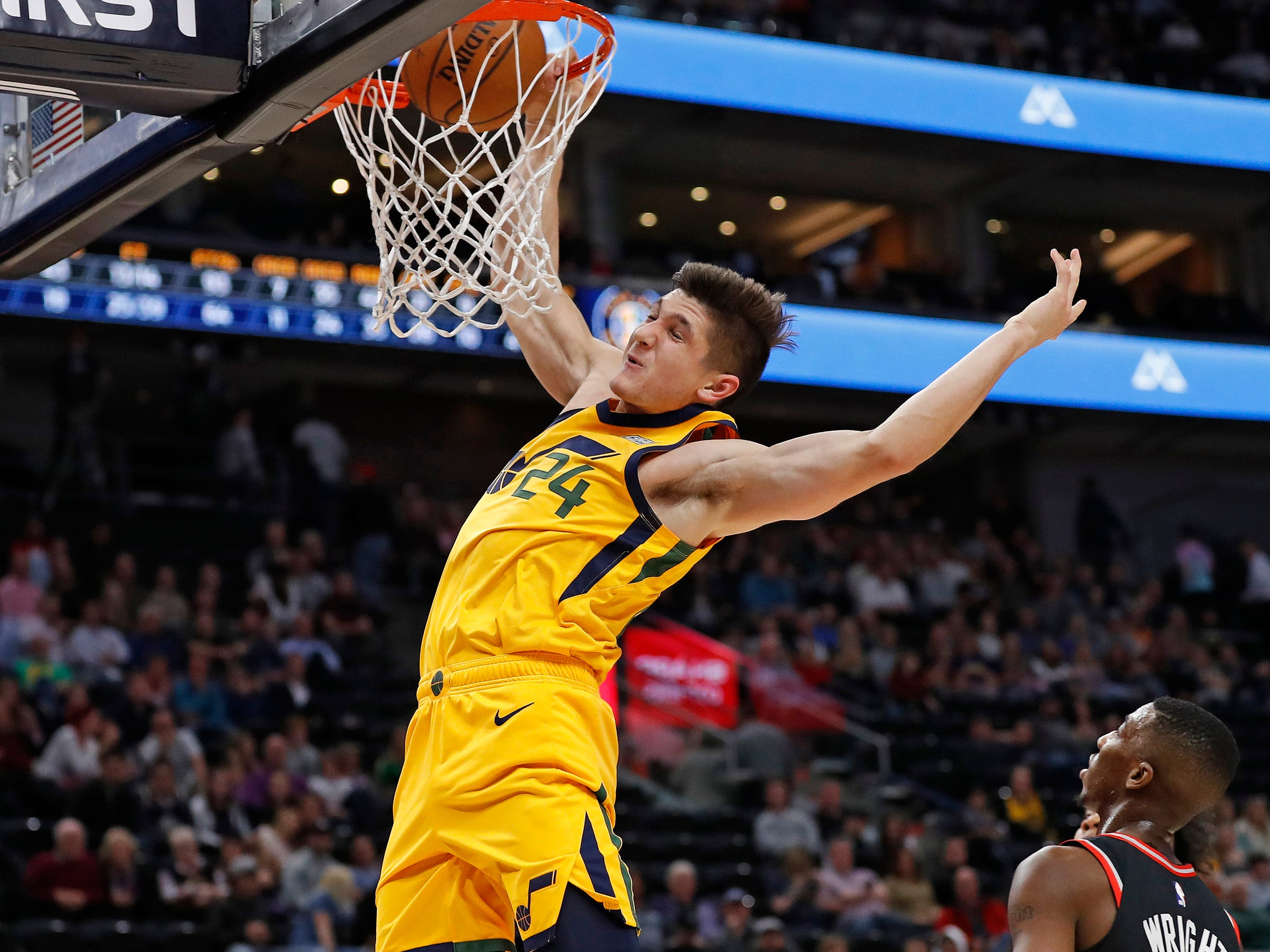 Nov. 5: Jazz guard Grayson Allen puts down a one-handed dunk during the fourth quarter against the Raptors in Salt Lake City.