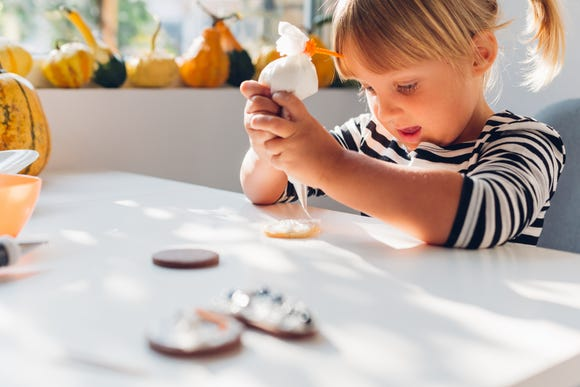 Keep the kids' table busy on Thanksgiving after the meal with cookie decorating.