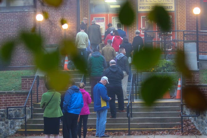 Voters head to the polls to cast their votes in the midterm election on Tuesday.