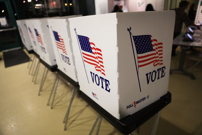 Booths are set up for early voting in Tampa, Fla.