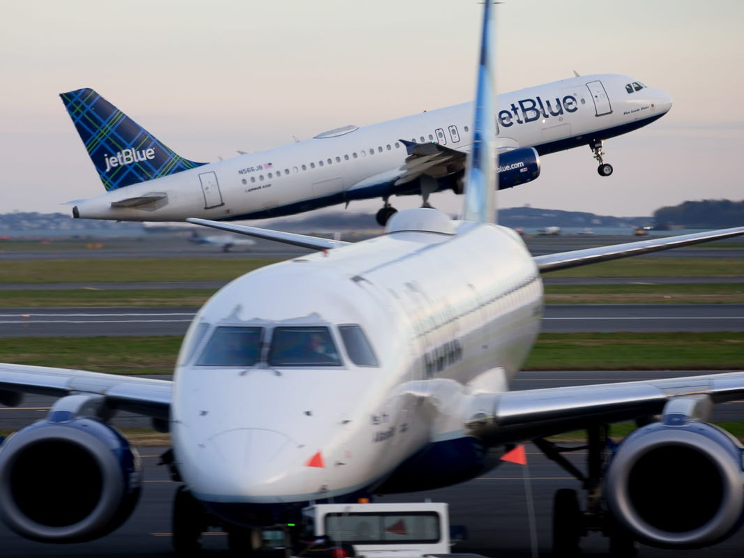 A jetBlue Airbus A320 takes off from Boston Logan International Airport in October 2018.