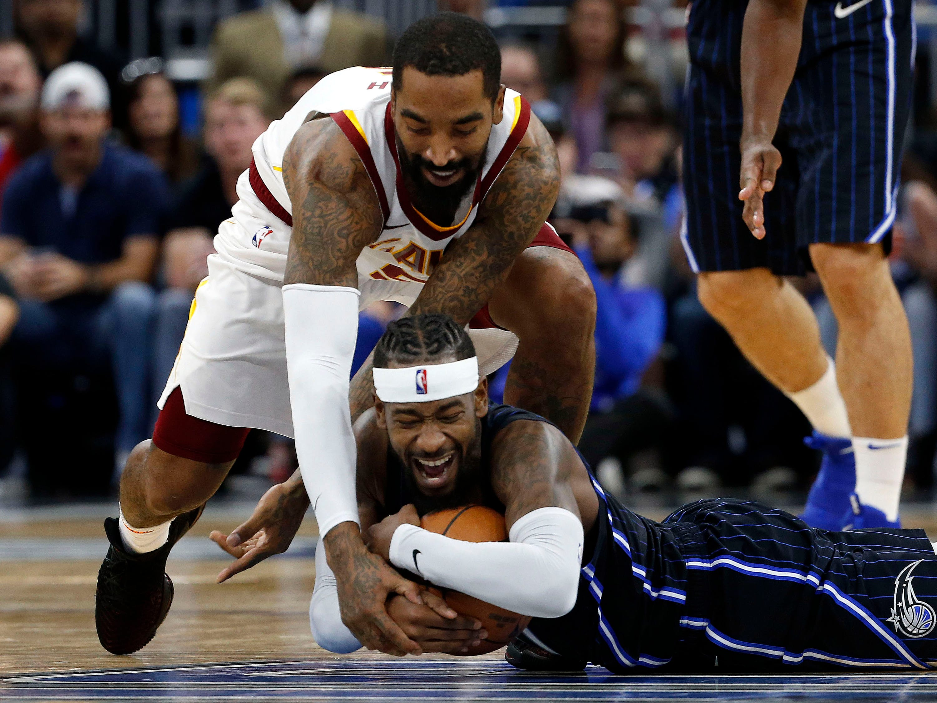 Nov. 5: Magic guard Terrence Ross (31) tries to corral a loose ball against Cavaliers guard J.R. Smith (5) during the second half in Orlando.