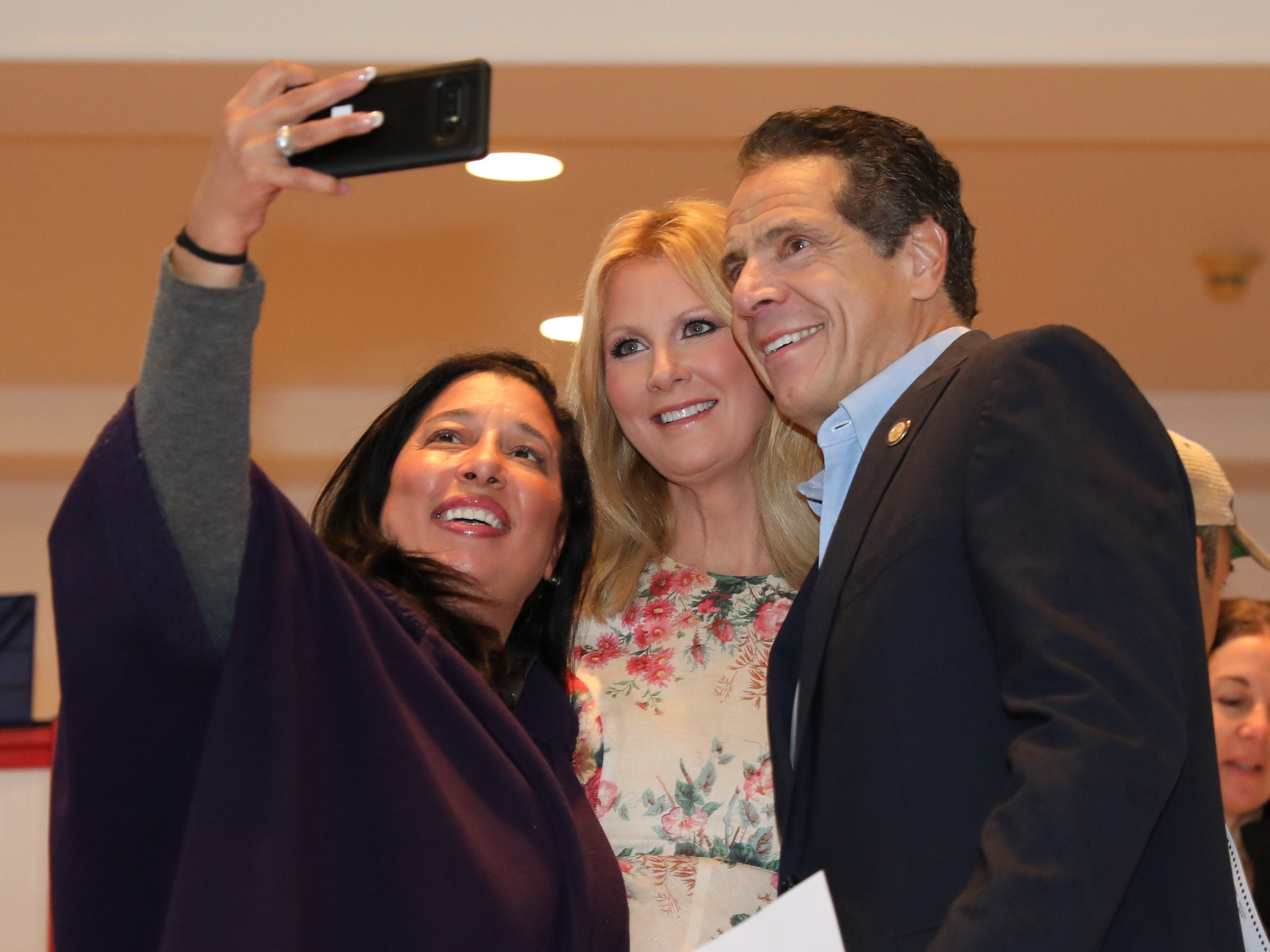 New York Governor Andrew Cuomo and girlfriend Sandra Lee take a selfie with a voter as they prepare to vote at the Presbyterian Church of Mount Kisco on Nov. 6, 2018.