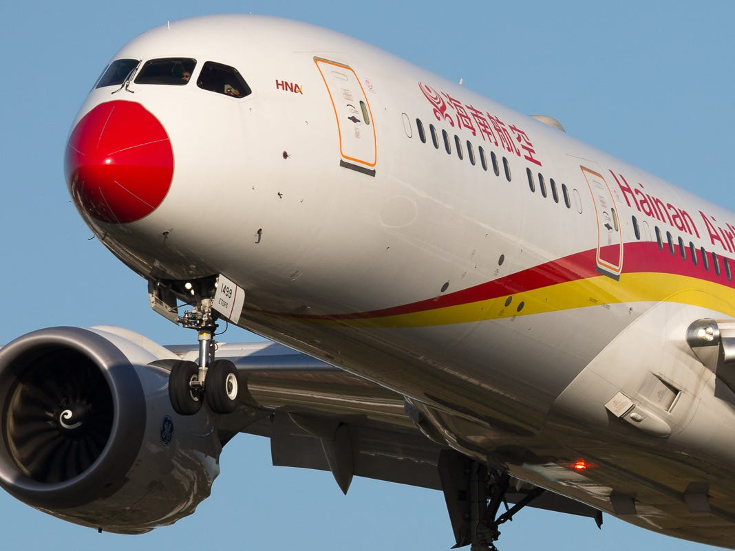 Bearing a small resemblance to Rudolph, a Hainan Airlines Boeing 787-9 lands at London's Heathrow International Airport in October 2018.