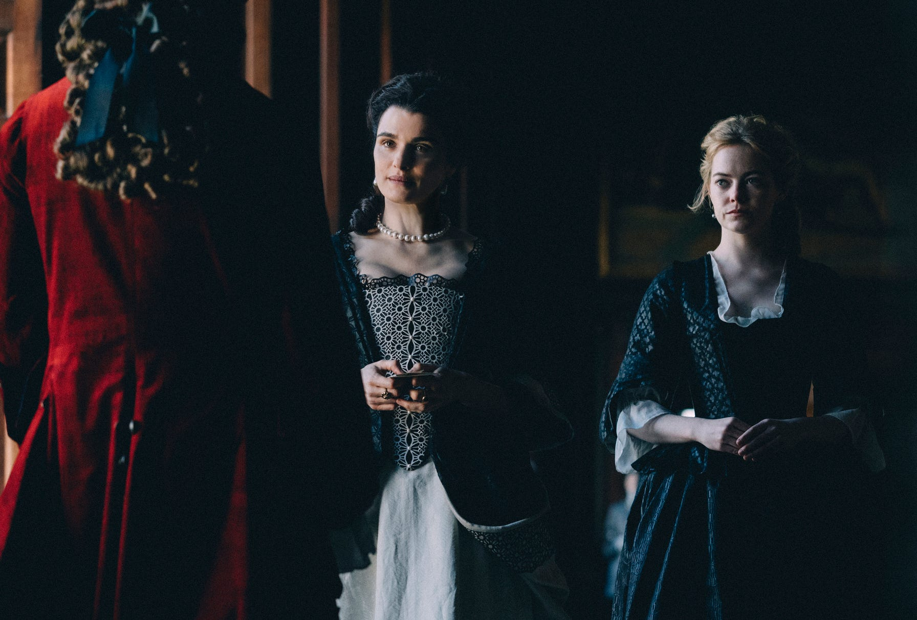 "Rachel Weisz (left) and Emma Stone, star in ""The Favourite"""