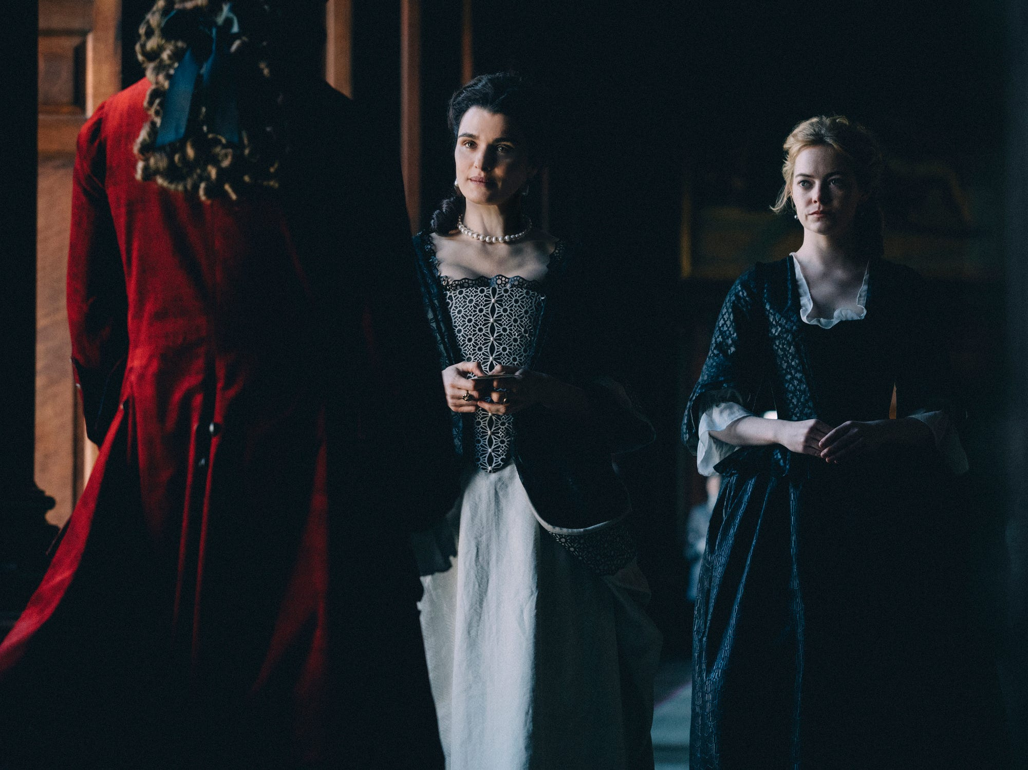 """The Favourite"" (R): Two ladies-in-waiting (Emma Stone and Rachel Weisz) attempt to yield power and privilege from Queen Anne (Olivia Colman, in an Oscar-worthy portrayal) in this humorous glimpse at 18th century English aristocracy. 