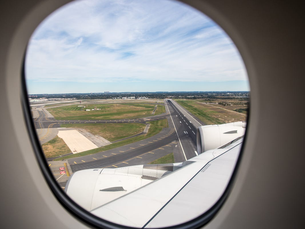 Runway 22L at New York's JFK International Airport appears out the window of a Singapore Airlines Airbus A380 as it lands at the well-known U.S. airport in October 2018.