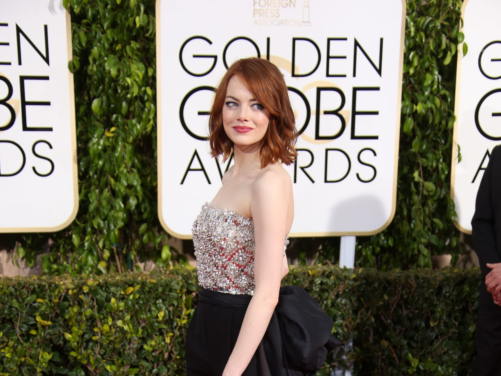 Emma Stone arrives super chic in a pants ensemble at the 72nd annual Golden Globe Awards.