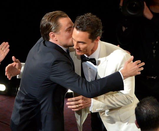 """Leonardo DiCaprio, who beat out  Matthew McConaughey for """"Titanic,"""" congratulates the Texan after he won his first Oscar in 2014 for """"Dallas Buyer's Club."""""""