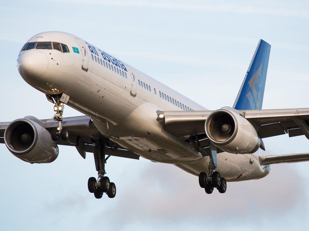 An Air Astana Boeing 757-200 lands at London's Heathrow International Airport in October 2018.