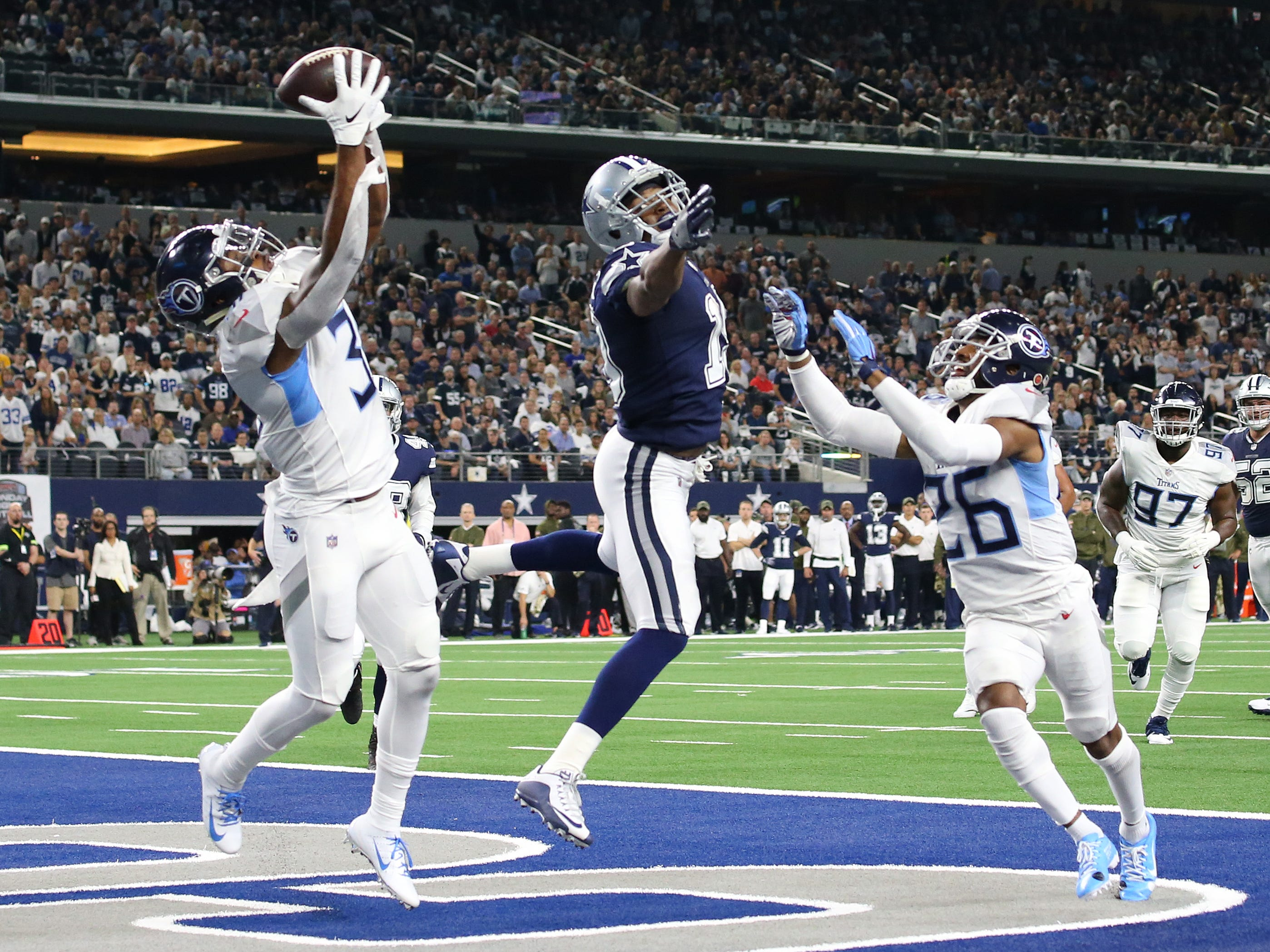Tennessee Titans safety Kevin Byard (31) intercepts the ball in the end zone intended for Dallas Cowboys receiver Amari Cooper (19) in the first quarter at AT&T Stadium.