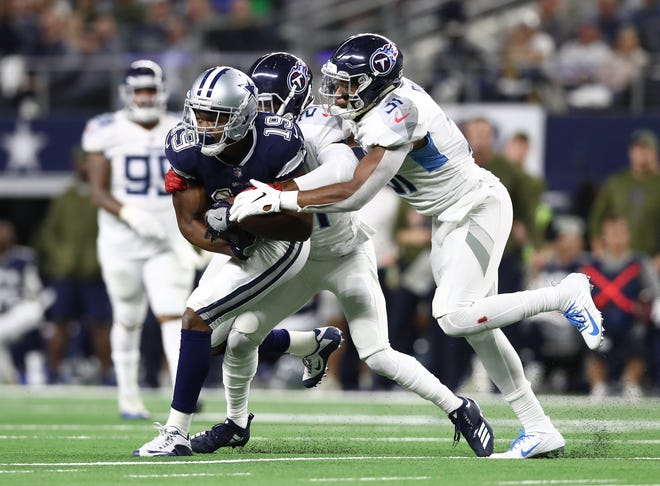 Dallas Cowboys receiver Amari Cooper (19) runs after a reception against Tennessee Titans safety Kevin Byrad (31) and cornerback Malcolm Butler (21) at AT&T Stadium.