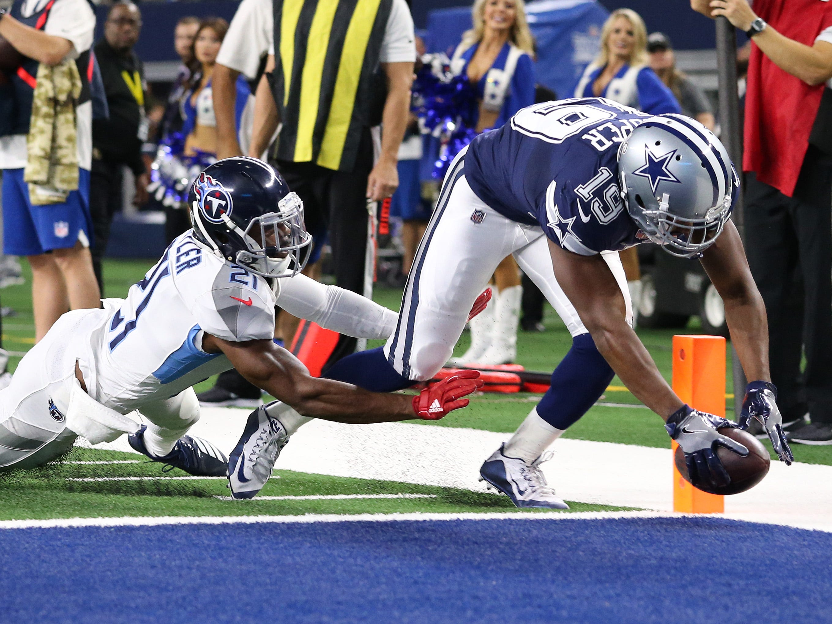 "Amari Cooper scores his first touchdown as a member of the Dallas Cowboys during the ""Monday Night Football"" game against the Tennessee Titans at AT&T Stadium."