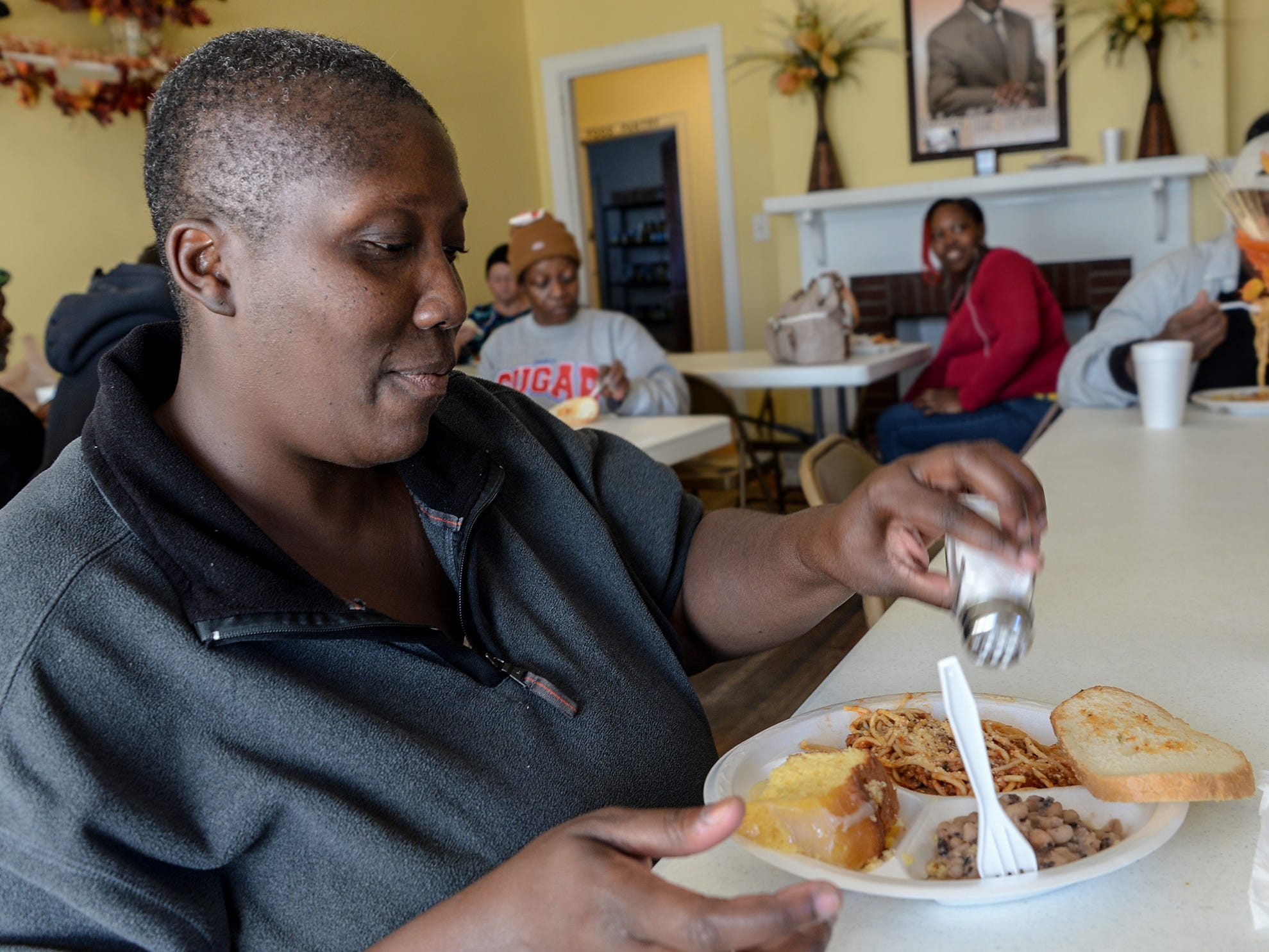 Patricia Allen eats a hot meals during a lunch hour at Anderson Soup Kitchen in November.