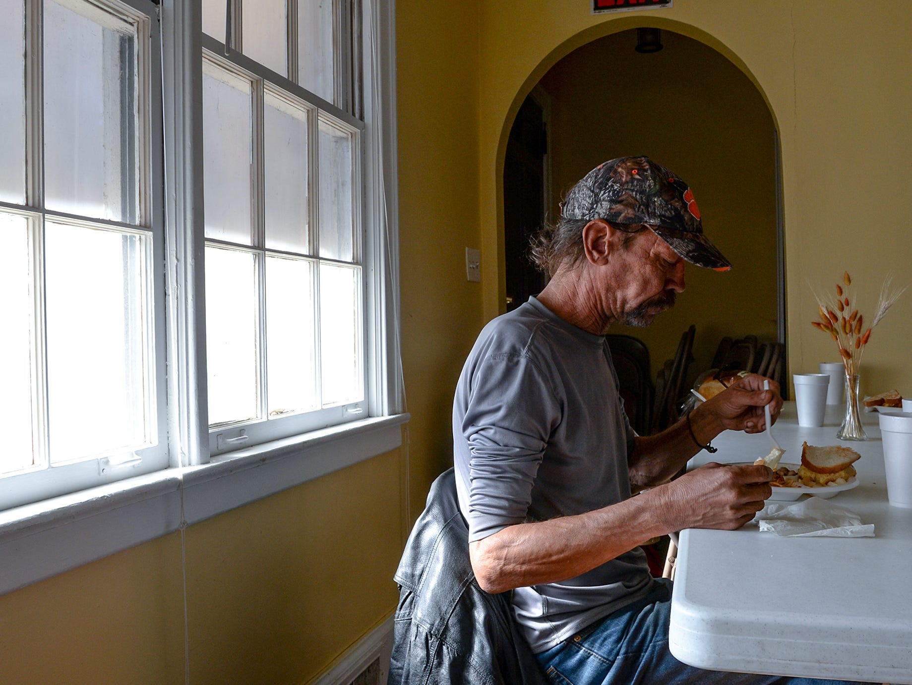 Sam Powers eats a hot meals during a lunch hour at Anderson Soup Kitchen in November.