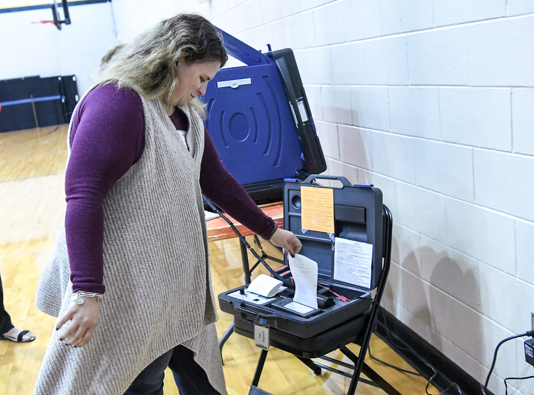Caitlin Phillips, a poll clerk at Hopewell precinct at T.L. Hanna High School, gets totals printed out after 7 p.m. in Anderson on Tuesday, November 6, 2018.