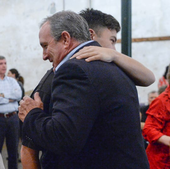 U.S. Rep. Jeff Duncan hugs his son Parker Duncan after thanking supporters during election night party in Anderson on Tuesday, November 6, 2018.