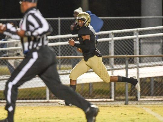 Pendleton senior Jamal Blakely runs by a Seneca defender for a touchdown during the fourth quarter at Pendleton High School in Pendleton on Monday, October 29, 2018.