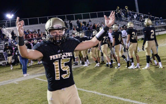 Pendleton senior Payton Bunch celebrates with teammates a 30-27 win over Seneca for the region championship, at Pendleton High School on Monday.