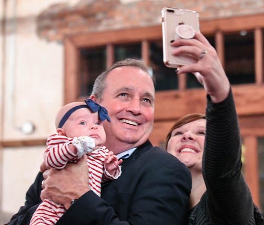 U.S. Rep. Jeff Duncan, middle, holds Ellyson Duncan, the baby of his niece in law Somer Duncan, right, getting a selfie photo, minutes before he was projected to win his fifth term in District 3, during election night party in Anderson on Tuesday, November 6, 2018.