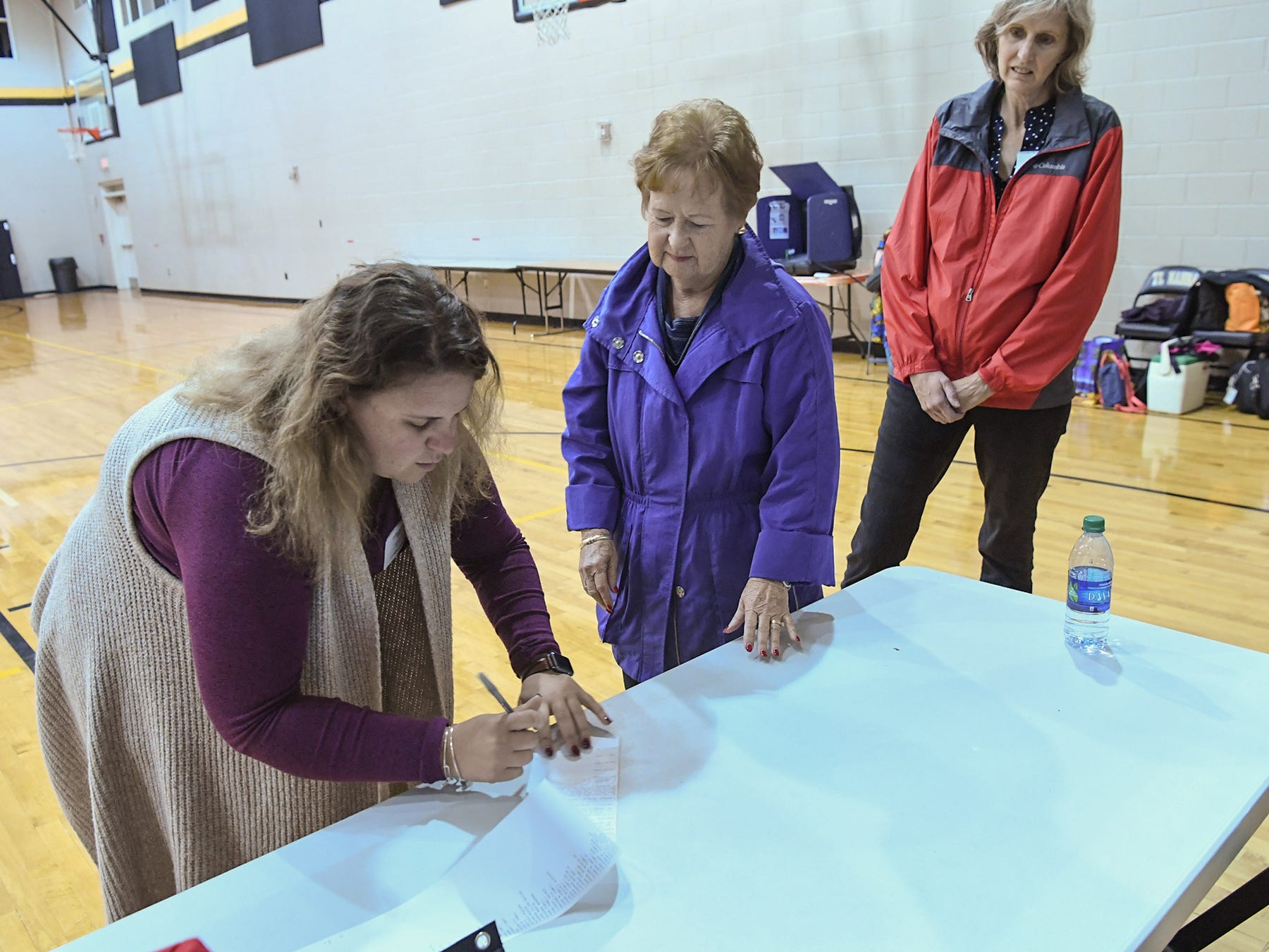 Caitlin Phillips, a poll clerk at Hopewell precinct at T.L. Hanna High School, signs off totals printed out after 7 p.m. in Anderson on Tuesday, November 6, 2018.