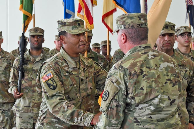Lt. Col. Willus Hall (left) recieves the 139th Regional Support Group colors from Maj. Gen. Glenn H. Curtis, adjutant general of the Louisiana National Guard during an official change of command ceremony at Jackson Barracks in New Orleans, November 4, 2018. Hall assumed command from Col. Stuart Burruss. (U.S. Army National Guard photo by Sgt. Garrett L. Dipuma)
