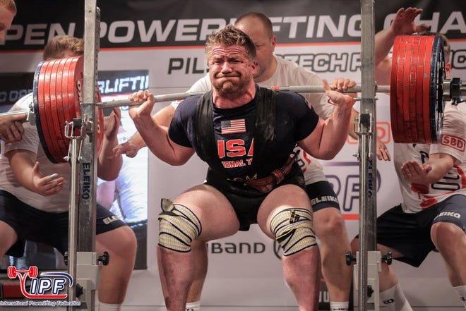 Quintin Meyer performs a squat during the 2017 World Open Powerlifting Championships in Luxembourg.