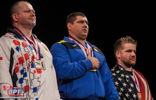 Quintin Meyer, right, earned a bronze medal at the 2017 World Open Powerlifting Championships in Luxembourg.