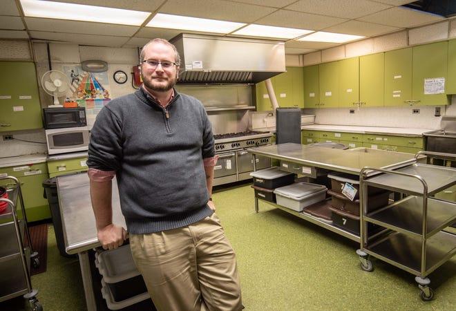 Rev. Jonathan Elsensohn in the kitchen of First Baptist Church in Freehold.