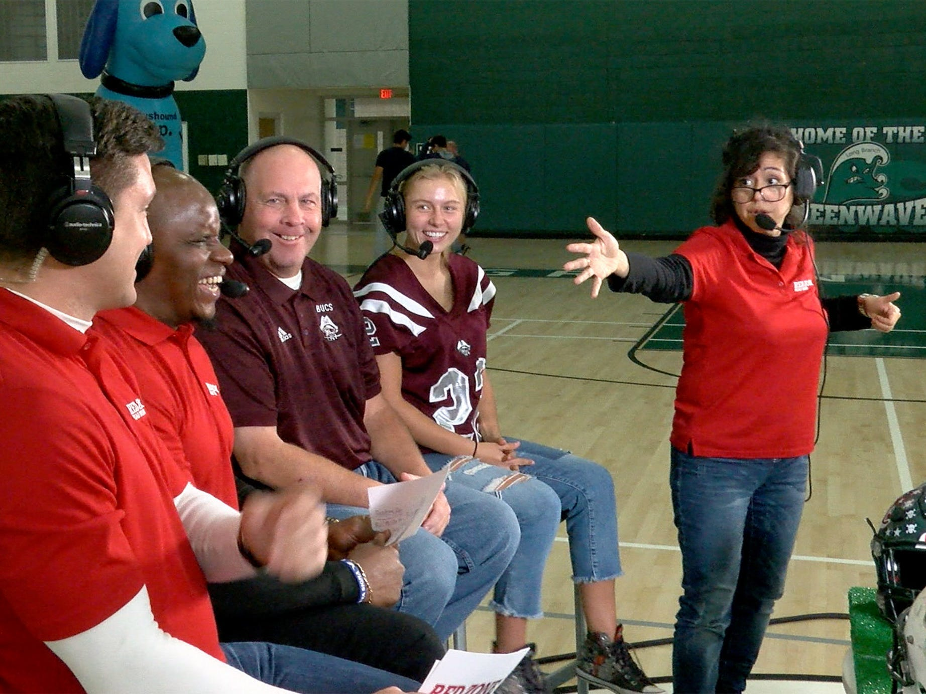 Cynthia Salinas directs Red Zone Road Show hosts Ryan Ross and Chris Melvin before taping a segment with Red Bank Regional Athletic Director Del Dal Pra 