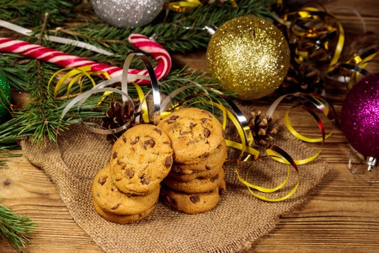 Chocolate Chip Cookies With Christmas Decoration On Wooden Table