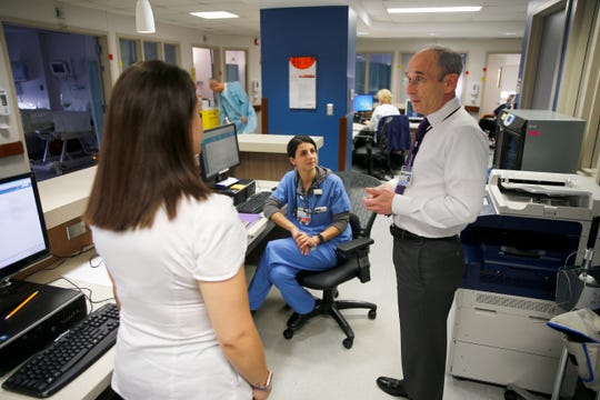 Dr. Todd Phillips speaks with nurses at Community Medical Center in Toms River Wednesday afternoon, November 7, 2018.  He has led the hospital's bid to improve quality.