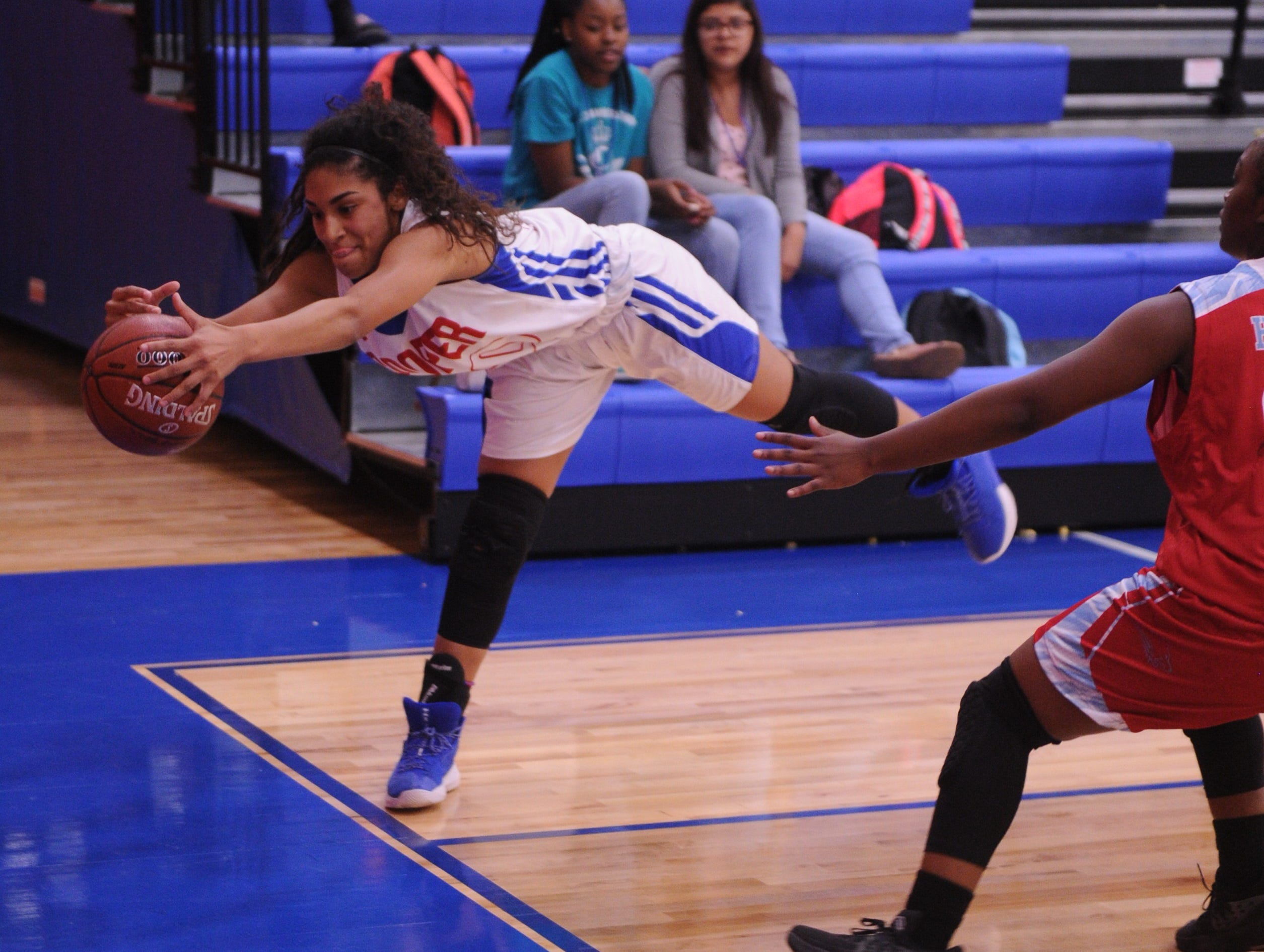 Cooper's Keiana Kemp, left, tries to come up with a loose ball before it goes out of bounds as a Wichita Falls Hirschi player defends. Hirschi won the game 51-37 in the season opener for both teams Tuesday, Nov. 6, 2018, at Cougar Gym.