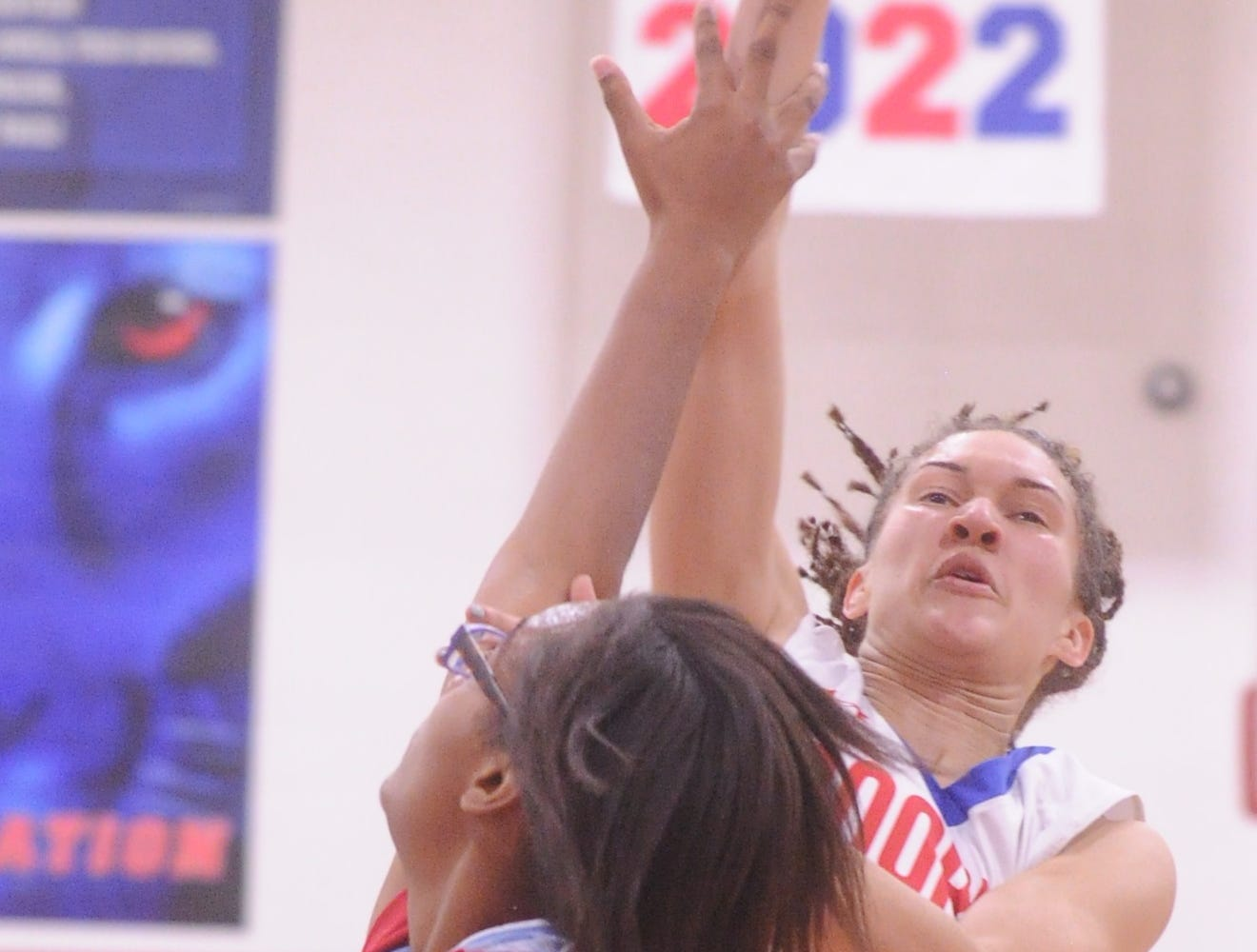 Cooper's Alexis Garcia shots over a Wichita Falls Hirschi defender. Hirschi won the game 51-37 in the season opener for both teams Tuesday, Nov. 6, 2018, at Cougar Gym.