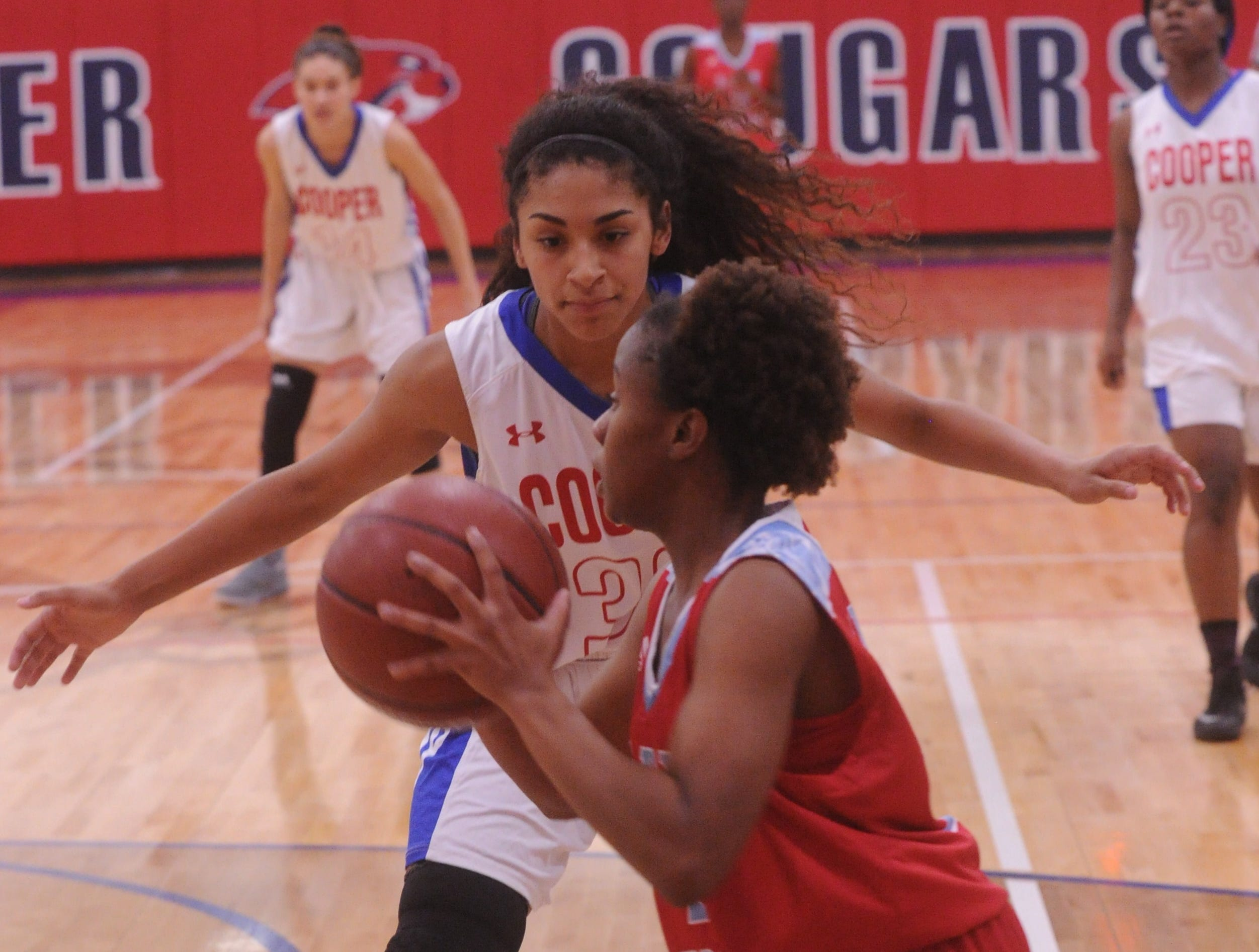 Cooper's Keiana Kemp puts pressure on a Wichita Falls Hirschi ball handler. Hirschi won the game 51-37 in the season opener for both teams Tuesday, Nov. 6, 2018, at Cougar Gym.