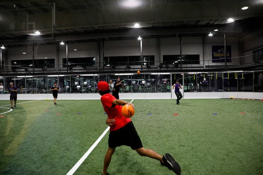 Hardin Simmons student John Esparza faces off against a quintet of opponents as his team's last man standing during the final dodgeball game of an event held by the Hardin Simmons Faith &  new health and fitness center.